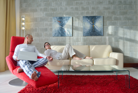 #29824035   Happy Young Couple Relax At Modern Home Living Room Indoor