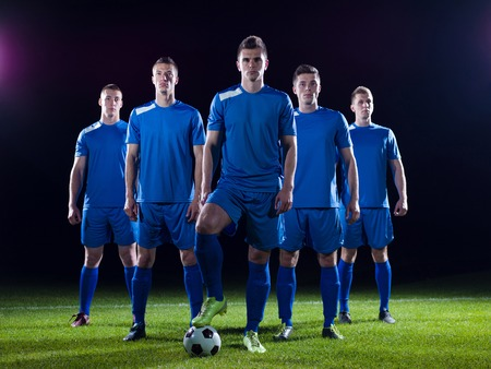 soccer players team group isolated on black background Archivio Fotografico