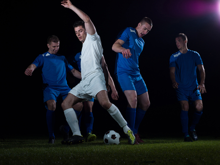 dribbling: soccer football team  player game duel isolated on black background