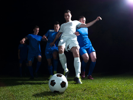 soccer football team  player game duel isolated on black background photo