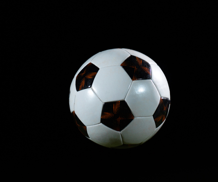 classic soccer football ball isolated on black background photo