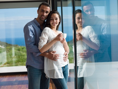 romantic happy young couple relax at modern home indoors photo