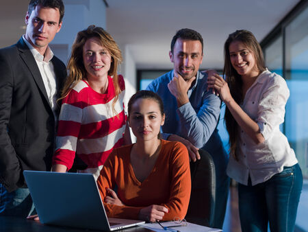 business people team on meeting at bright office space working on laptop computer photo