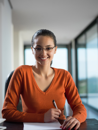 young business  woman working on laptop computer at modern home office photo