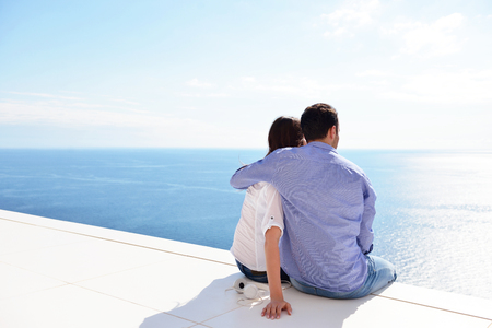 romantic happy young couple relax at modern home outdoors photo