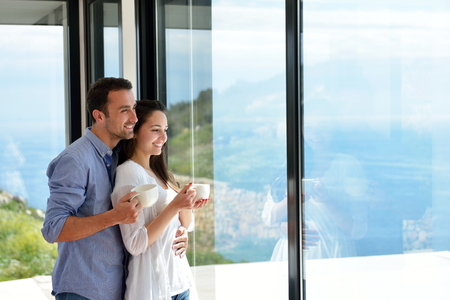 relaxed: romantic happy young couple relax at modern home indoors Stock Photo