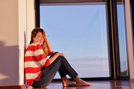 young woman relaxing   at home balcony   photo