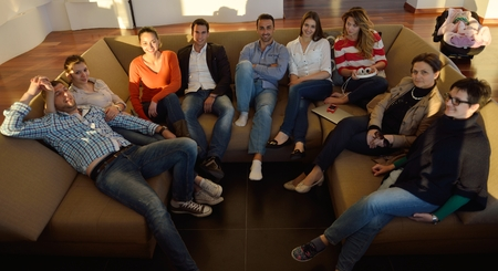 school friends: business people team on meeting at bright office space working on laptop computer