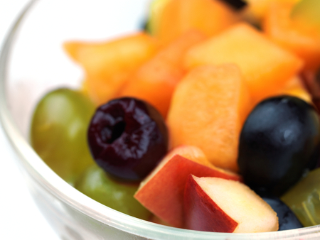 salad with fresh fruits and berries healthy food isolated on white backgound photo