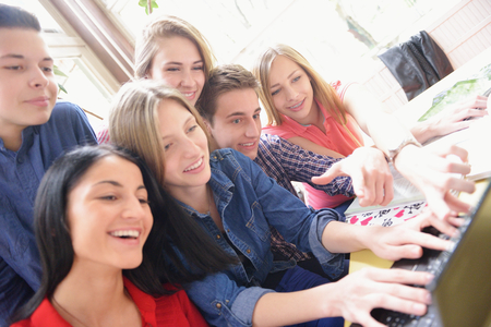 happy young teens group in school have fun an learning lessons photo
