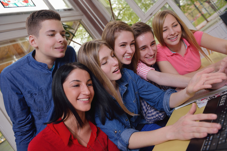 classmates: happy young teens group in school have fun an learning lessons