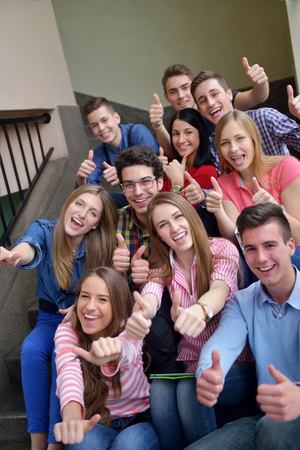 highschool student: happy young teens group in school have fun an learning lessons