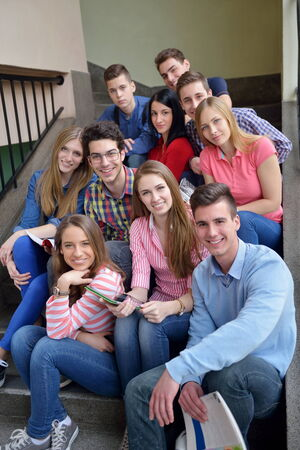school friends: happy young teens group in school have fun an learning lessons