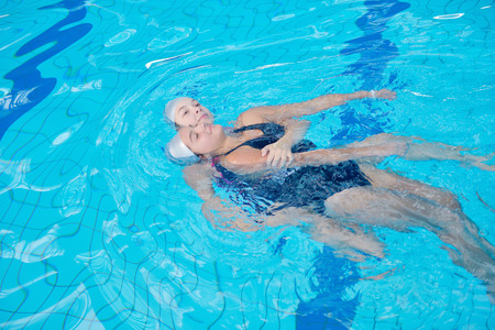 rescuing: help and rescue action in swimming school at pool