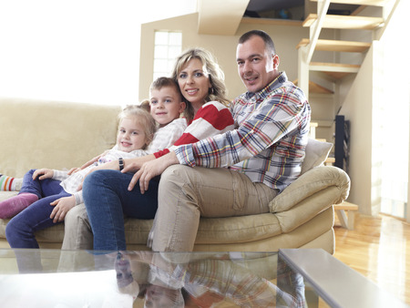 hapy young family have fun  with their children at modern living room home indoors photo