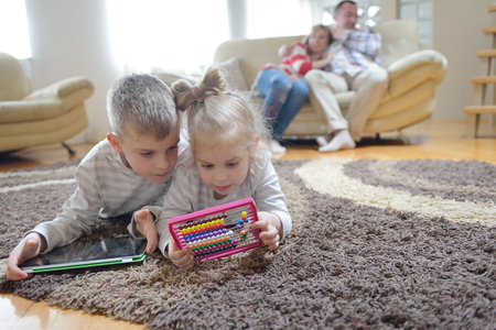 living room boy: hapy young family have fun  with their children at modern living room home indoors