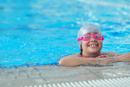 group of happy kids children   at swimming pool class  learning to swim 스톡 콘텐츠