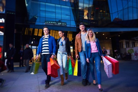 Group Of Friends Enjoying Shopping Trip Together group of happy young friends enjoying shopping night photo
