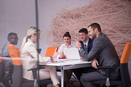 office staff: young business people group have meeting and working in modern bright office indoor