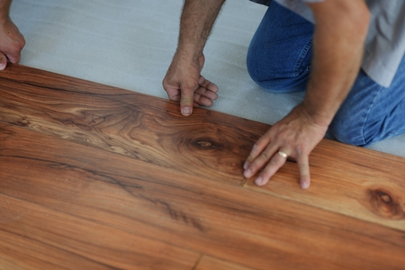 contractor: Installing laminate flooring in new home indoor