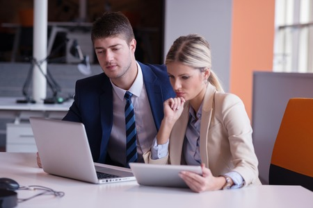 couple talking: young business people group have meeting and working in modern bright office indoor