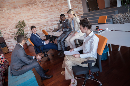 young business people group have meeting and working in modern bright office indoor photo