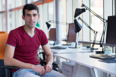 happy young business man portrait in bright modern office indoor photo