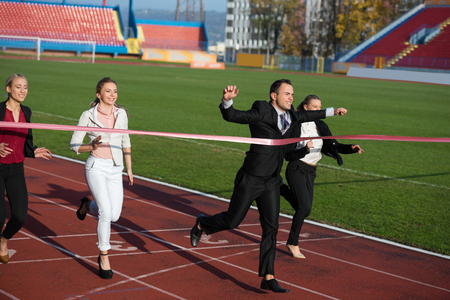 contender: business people running together on racing track