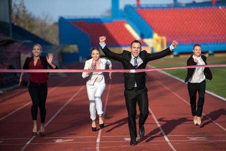 sprint: business people running together on racing track