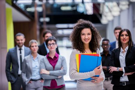 office worker: multi joven grupo permanente de personas de negocios �tnicos caminar y vista desde arriba Foto de archivo