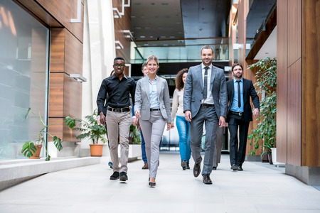 multi ethnic: young multi ethnic business people group walking standing and top view