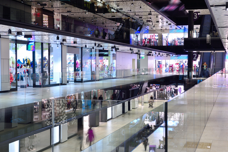 retail scene: modern bright shopping mall indoor architecture Stock Photo