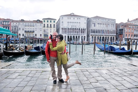 marco: happy young romantic couple in love  travel and have fun in venice Stock Photo