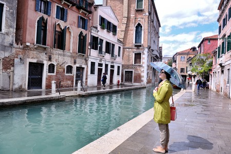 Beautiful tourist woman in Venice, exploring the old city photo