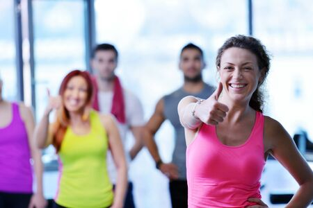 staff training: Group of people exercising at the gym and stretching