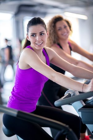 sports hall: group of young people running on treadmills in modern sport  gym