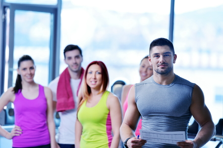 back training: Group of people exercising at the gym and stretching