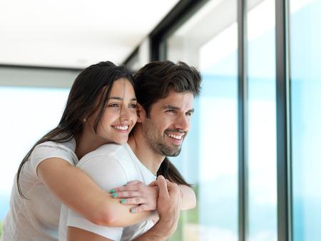 indoors: romantic happy young couple relax at modern home indoors and have fun
