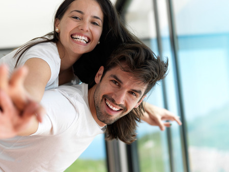 romantic couples: romantic happy young couple relax at modern home indoors and have fun