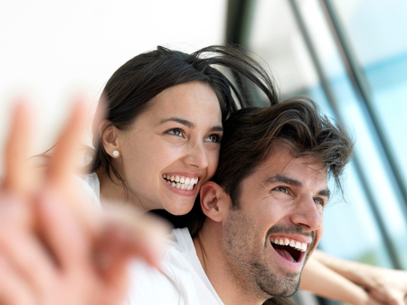 tv home: romantic happy young couple relax at modern home indoors and have fun