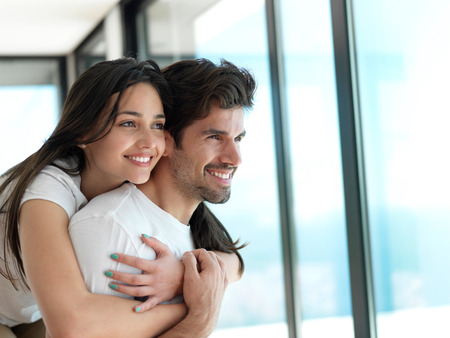 romantic happy young couple relax at modern home indoors and have fun photo