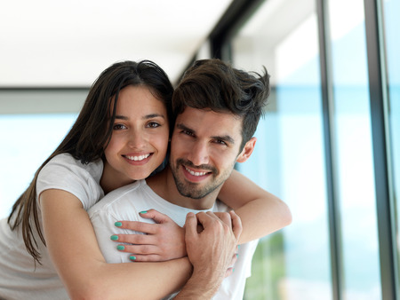 happy couple: romantic happy young couple relax at modern home indoors and have fun