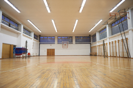 indoors: elementary school gym indoor with volleyball net