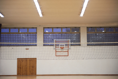 elementary school gym indoor with volleyball net photo