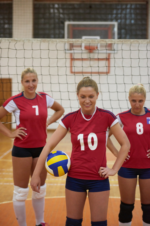 school gym: volleyball game sport with group of young beautiful girls indoor in sport arena school gym Editorial