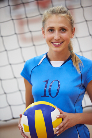 volleyball game sport with group of young beautiful girls indoor in sport arena school gym photo