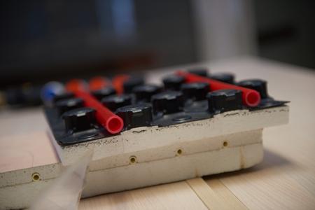 plastic conduit: Black underfloor heating posed in a under construction building Stock Photo