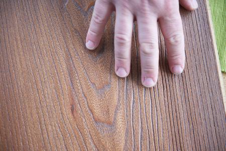 variants: wood floor parquet shop selecting variants hands closeup