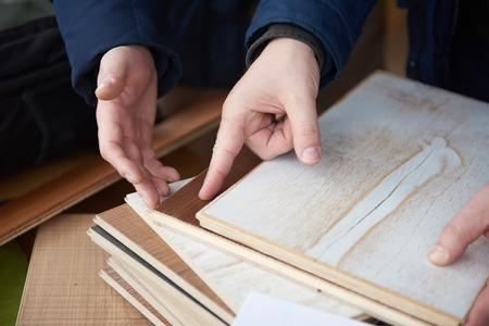 wood floor parquet shop selecting variants hands closeup photo