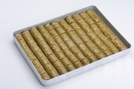 baklawa: traditional dessert turkish baklava,well known in middle east and delicious isolated on white background